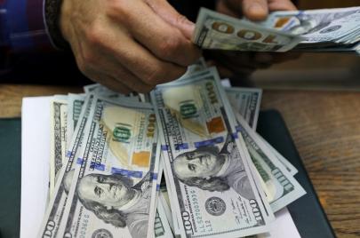 الرافدين يعلن إعادة العمل بنافذة بيع الدولار